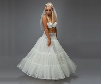 bride in a white petticoat looking down