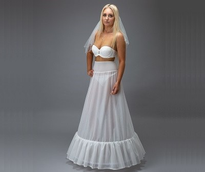 bride in a white petticoat with hand on hip