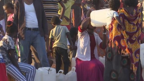 Tigray refugees queue for supplies at Sudan camp