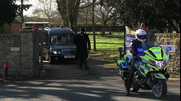 Coffin of fundraising hero arrives at crematorium