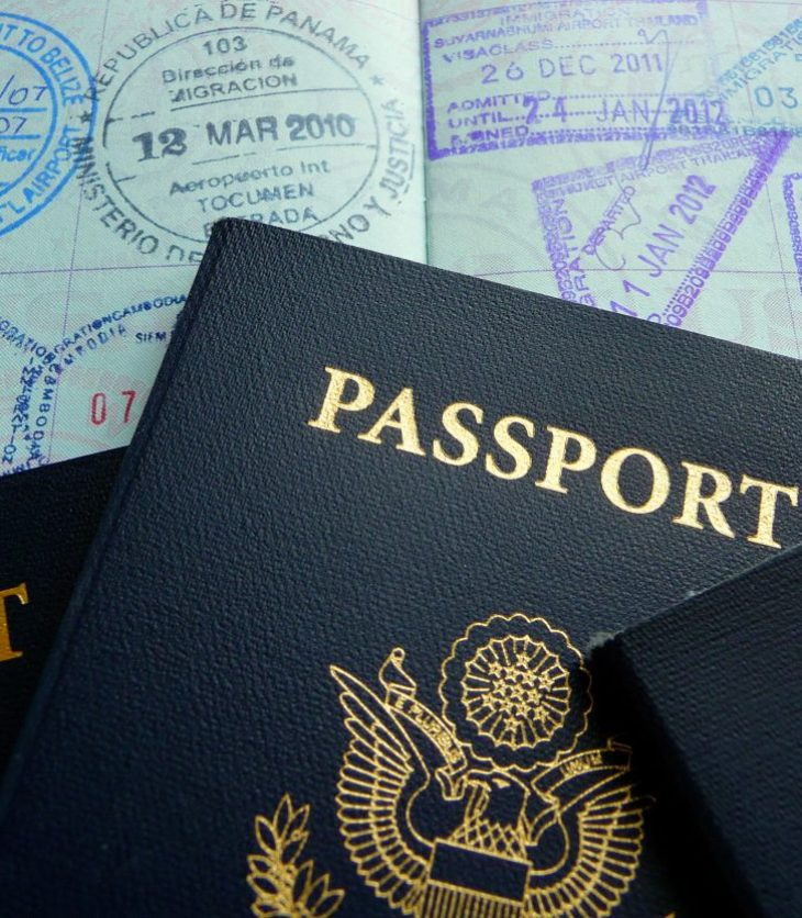 4 passports with a lot of passport stamps