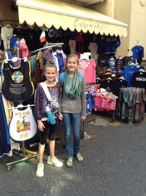 Two girls standing in front on shop in Sorento