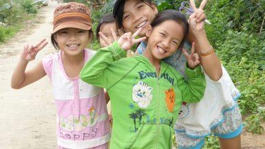 Four smiling Vietnamese girls