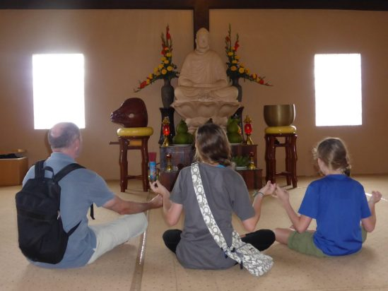 Family meditates at Truc Lam