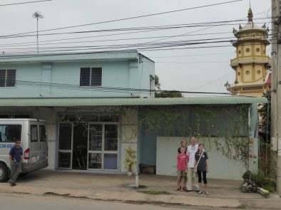 Outside the restaurant, the Cao Dai temple is in the background.