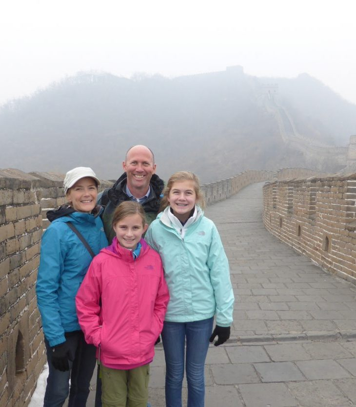 Family standing on the Mutianyu section of the Great Wall