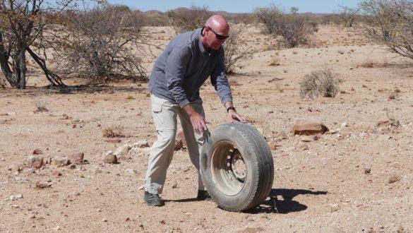 Rolling tire in Namibia desert
