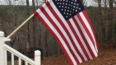 American flag hanging from house