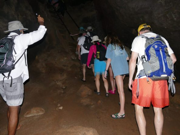 walking through a dark lava tunnel on Floreana Island