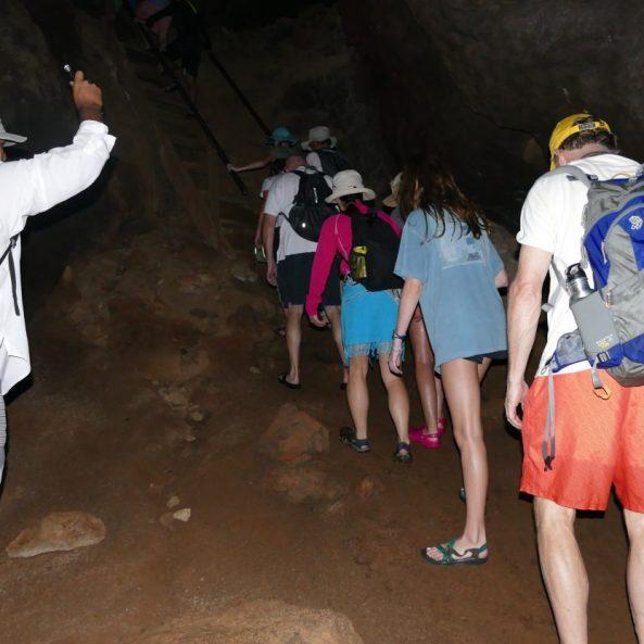 walking through a dark lava tunnel on Floreana Island
