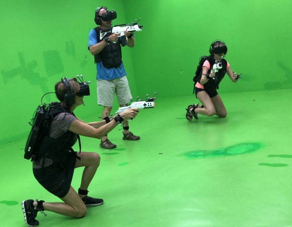 Family killing zombies at Sandbox Virtual Reality in Singapore. Top things to do in Singapore with kids and teens.