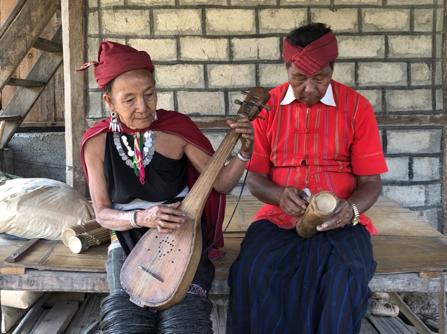 Hta Nee La Leh village musicians Daw Soe Myar and U Mi Reh play their handmade instruments. The duo have 7 children and 30 grandchildren.
