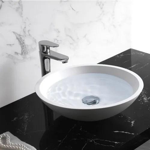 white stone table top wash basin