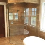 Floor to ceiling stone tile shower installation