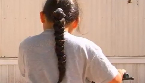 Navajo boy sent home for long hair.