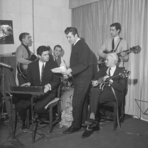 The Tornadoes in the studio, with Joe Meek (standing)