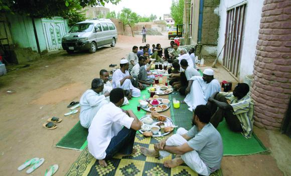 Men waiting for the Mughrib Azan in a neighbourhood in Khartoum. (Source: www.arabnews.com)