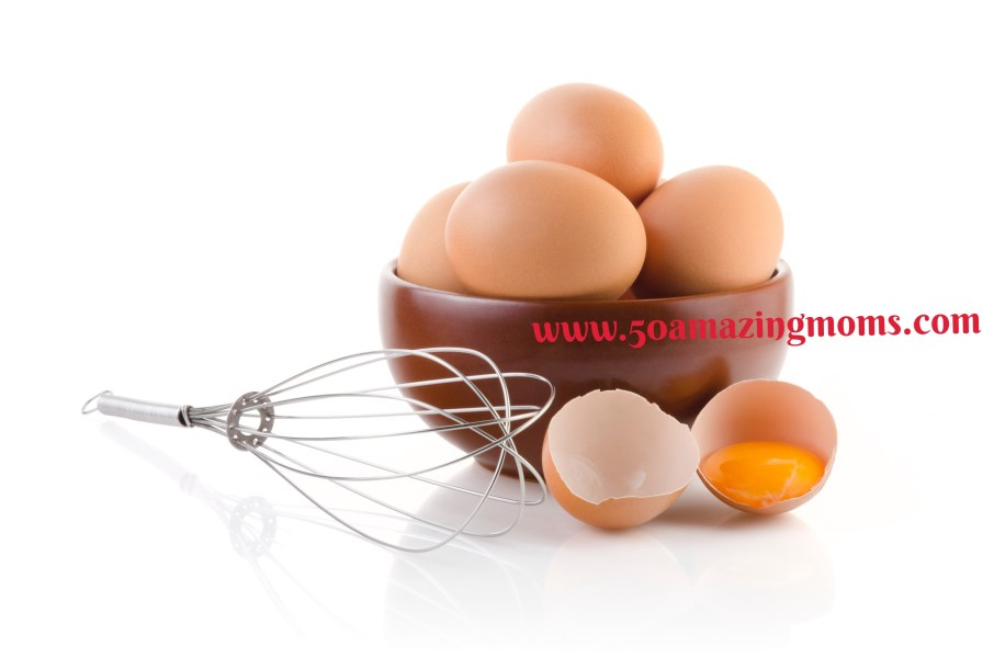 Brown Eggs in a bowl with whisk