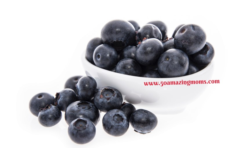 Blueberries in a bowl isolated on white