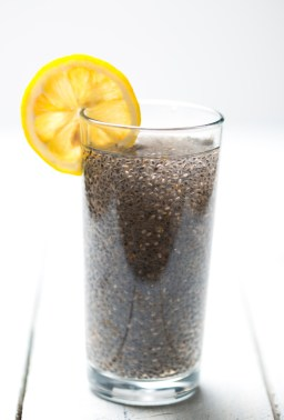 close up of a glass of chia seeds soaked in water with lemon (chia fresca)