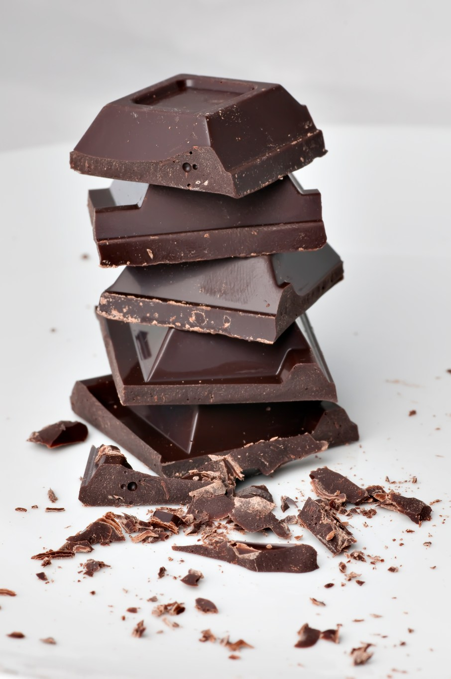 A pile of chocolate blocks on white background