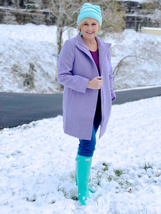 A fitted purple wool coat with blue boots