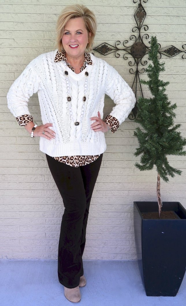 Fashion Blogger 50 Is Not Old wearing an ivory cable knit sweater with brown corduroy pants and ankle booties