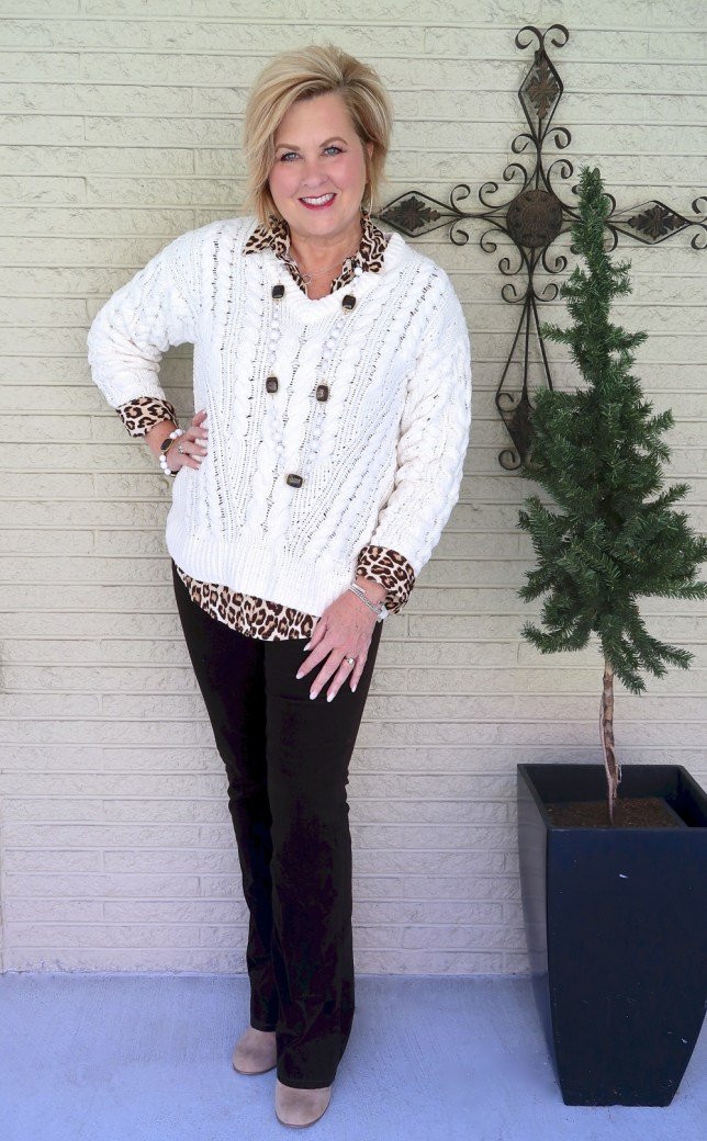 Fashion Blogger 50 Is Not Old wearing an ivory cable knit sweater and brown corduroy pants