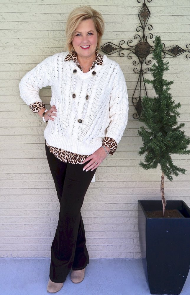 Fashion Blogger 50 Is Not Old wearing an ivory cable knit sweater