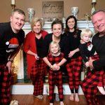 family photo in buffalo plaid pajamas