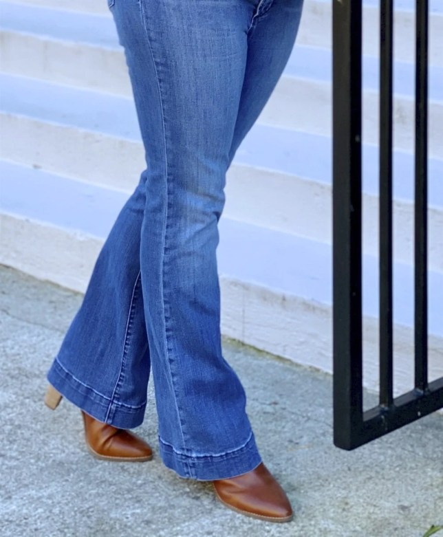 50 Is Not Old Fashion Blogger wearing flare jeans and ankle boots