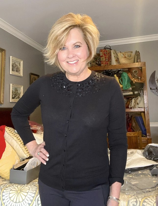 Fashion Blogger 50 Is Not Old holds a try on session with a black cardigan sweater