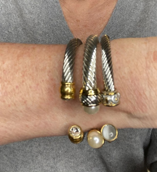 Fashion Blogger 50 Is Not Old holds a try on session and shows an up close photo of silver bracelets