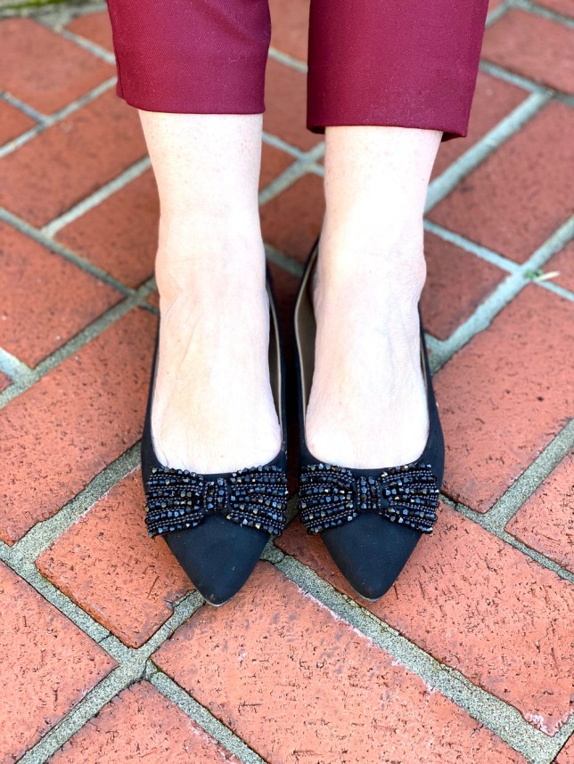 black jeweled flats worn by Fashion Blogger 50 Is Not Old