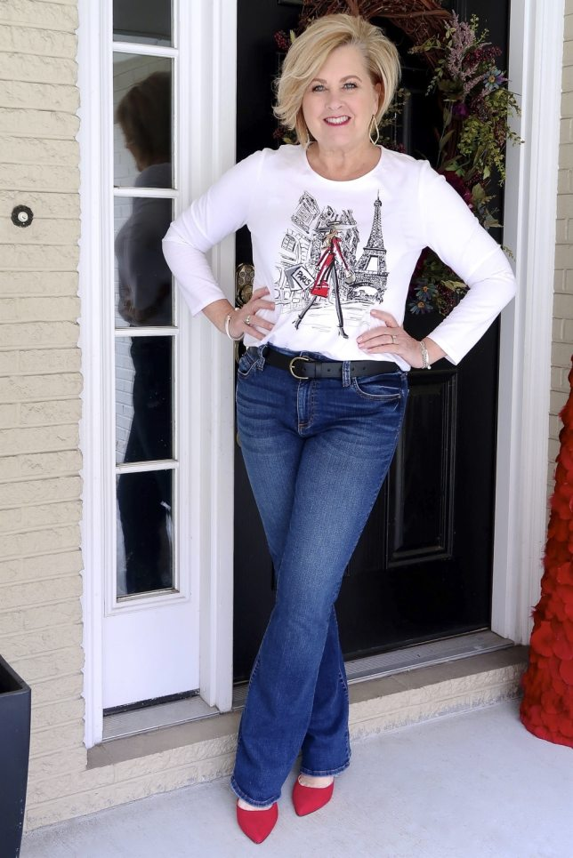 FASHION BLOGGER 50 Is Not Old styles a graphic Paris tee with jeans in multiple ways
