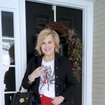 FASHION BLOGGER 50 IS NOT OLD IS WEARING A BLACK DENIM JACKET AND A GRAPHIC TEE FROM CHICO'S