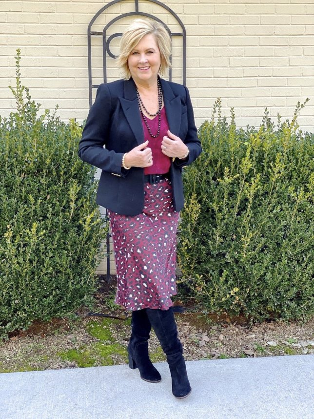Office wear by fashion blogger 50 is not old. Leopard print skirt, black blazer, and black knee boots