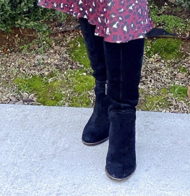 Outfit for an office setting by fashion blogger 50 is not old. Styling black knee boots with a wine leopard print skirt