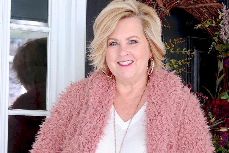 Fashion Blogger 50 Is Not Old is wearing a pink sherpa warm and cozy coat