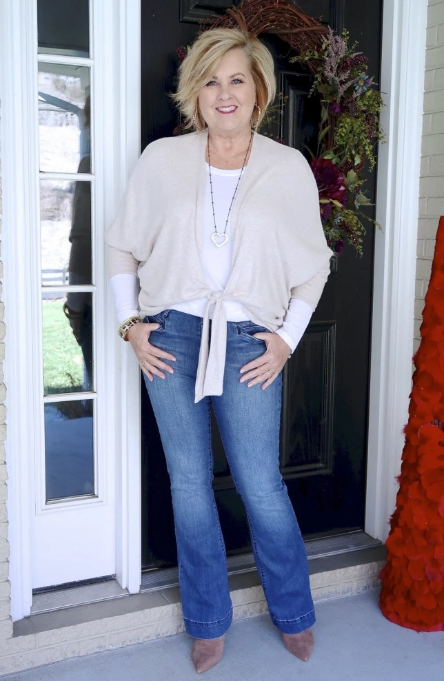Casual style from Fashion Blogger 50 Is Not Old in a put together look, a neutral tie-front cardigan from Chico's, flare jeans, and pointy boots