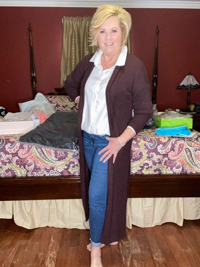 A white shirt and jeans with a burgundy long cardigan worn by fashion blogger 50 Is Not Old