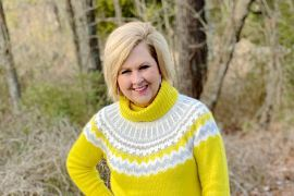 Fashion Blogger 50 Is Not Old wearing a yellow turtleneck sweater