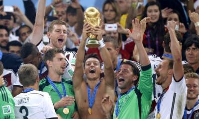 """Mesut Ozil celebrating world cup win with other germans football - 20201208 074341 - Football:"""" You are not a fan of World Champions""""-Ozil banters Piers Morgan"""