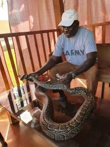 Tukur Buratai with one of his snakes photos: tukur buratai spend time with his huge snake - 20201217 071434 225x300 - Photos: Tukur Buratai spend time with his huge snake photos: tukur buratai spend time with his huge snake - 20201217 071434 - Photos: Tukur Buratai spend time with his huge snake