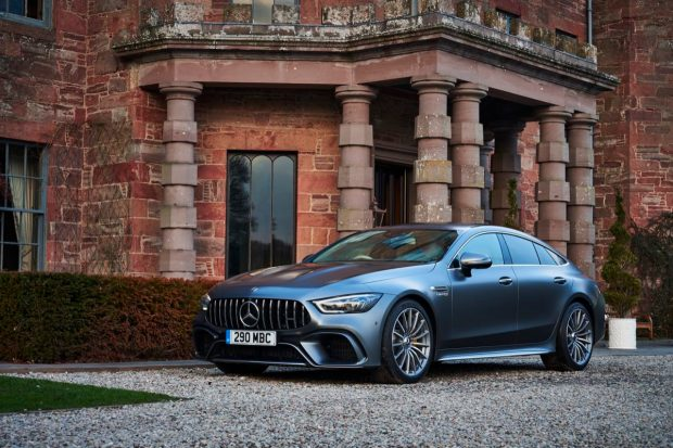Mercedes-AMG GT four-door parked on gravel