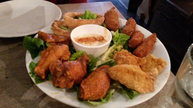 Jalapeno Poppers, Chicken Wings, Onion Rings, Fried Mozzarella Sticks, and Fried Catfish