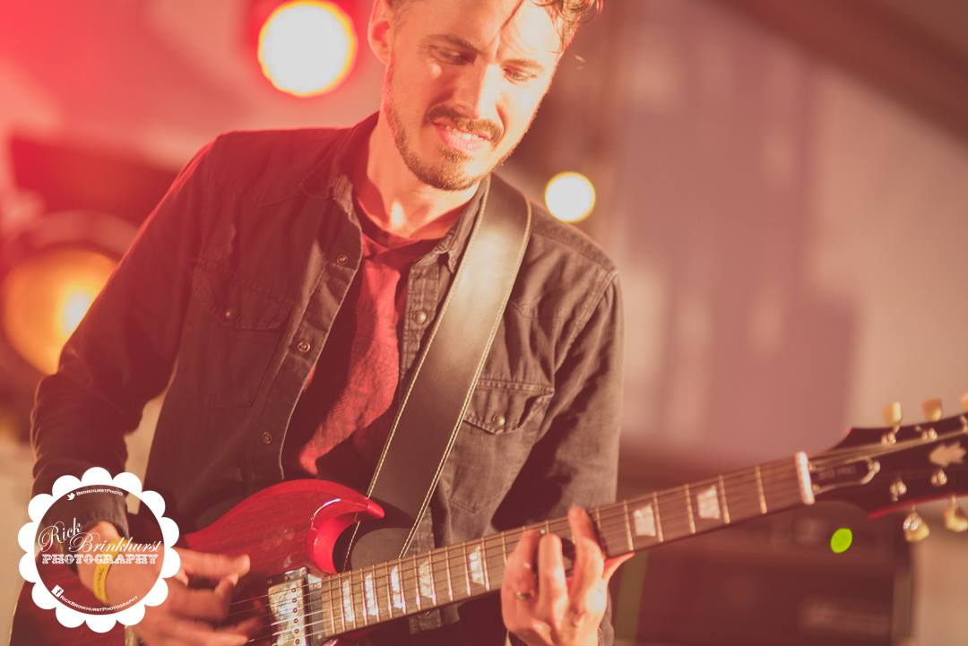 Andy Limn playing guitar with 50 Year Storm playing the BBC Introducing stage at Looe Music Festival 2017