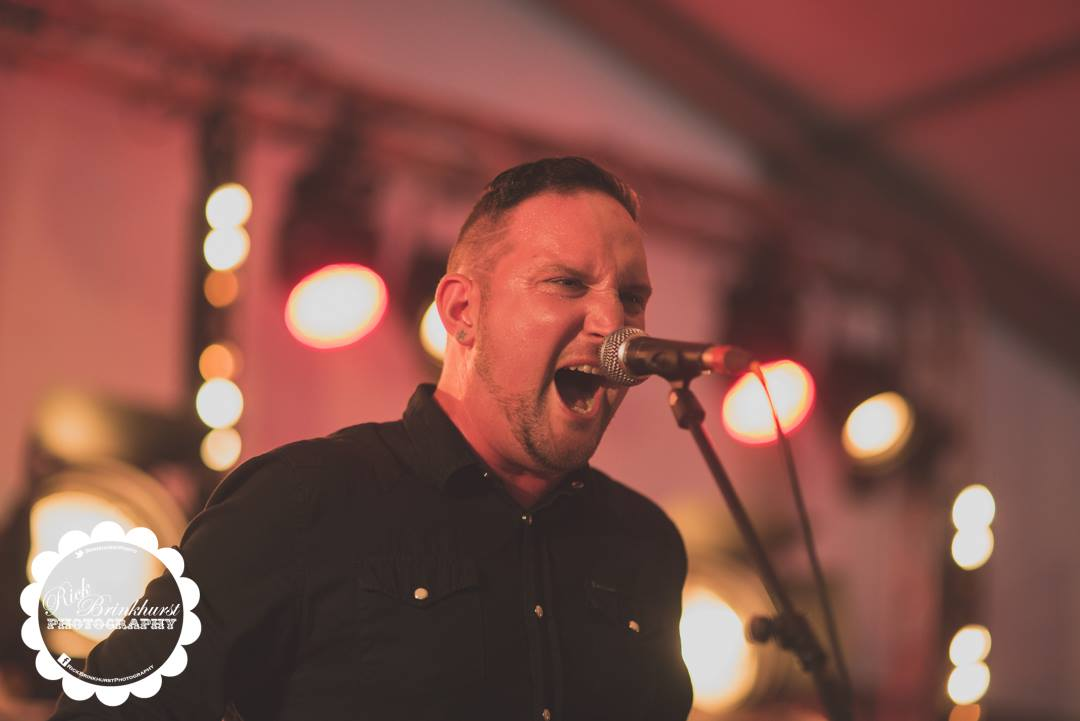 Damon Morey singing with 50 Year Storm on the BBC Introducing stage at Looe Music Festival 2017