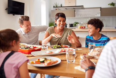 Quote Family Breakfast is being eaten by multigenerational mixed race family