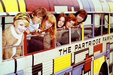 A picture of the Partridge family on their famous bus it's the like the quarantine where families are living in small quarters all together.